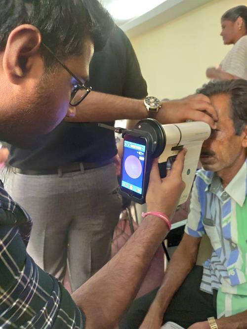 Patient being examined with Remidio device